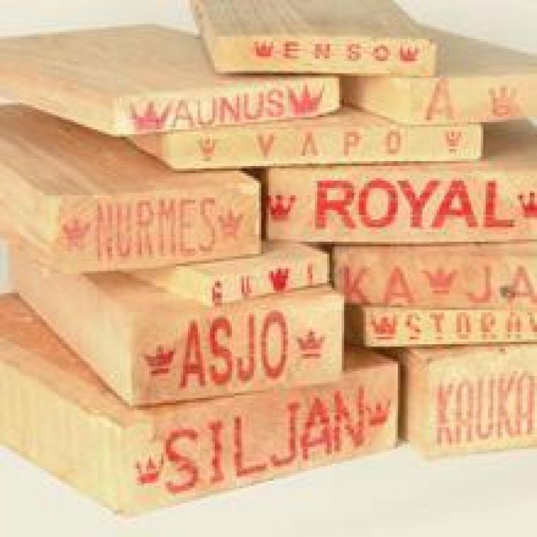 The names printed on the ends of these planks identify the origin of the timber