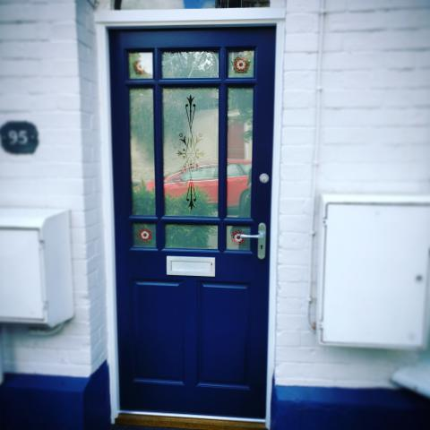 Blue front door with stained effect glazing
