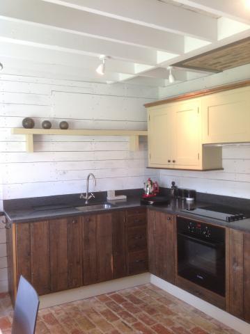 Fitted kitchen utilising floor boards