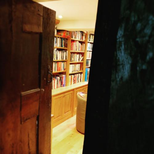 Through the doorway into a bespoke Oak library