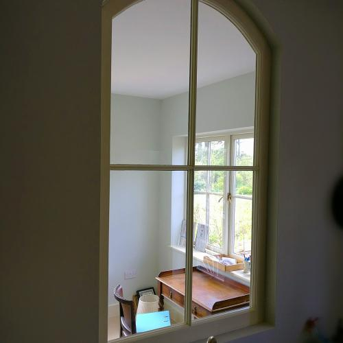 Swept head window made for a kitchen